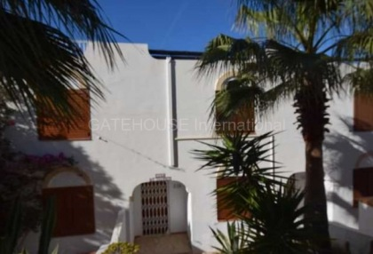 Townhouse for sale in Cala Tarida first line to the sea_1