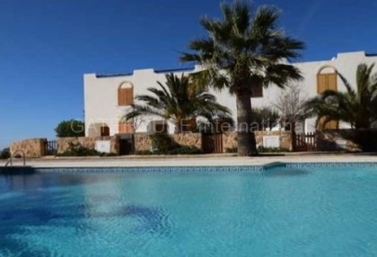Townhouse for sale in Cala Tarida first line to the sea_s
