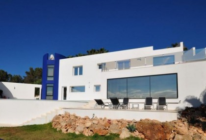 Modern villa in Cala Conta with sea and sunset views_1