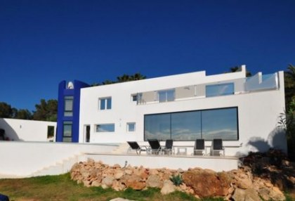 Modern villa in Cala Conta with sea and sunset views_s