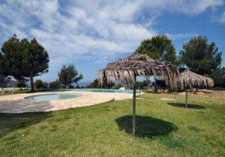 Two bedroom home with front and rear gardens in Cala Moli, ibiza