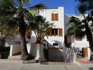 Terraced home overlooking the beach of  Cala Tarida