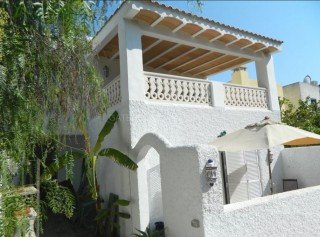 Townhouse with separate Penthouse for sale in Cala Tarida