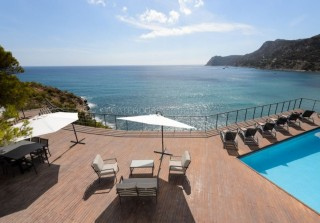 Frontline luxury home for sale in Es Cubells