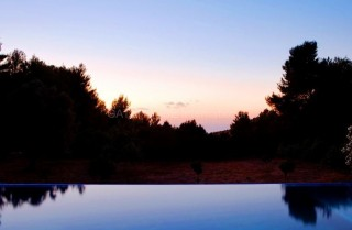 North Ibiza sunset & sea views from this private modern villa with extensive grounds